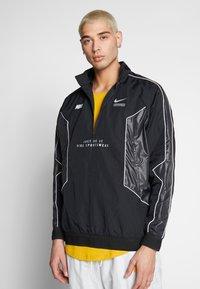 Nike Sportswear - TOP - Giacca a vento - black/black - 0