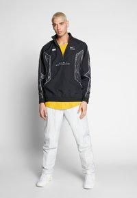 Nike Sportswear - TOP - Giacca a vento - black/black - 1