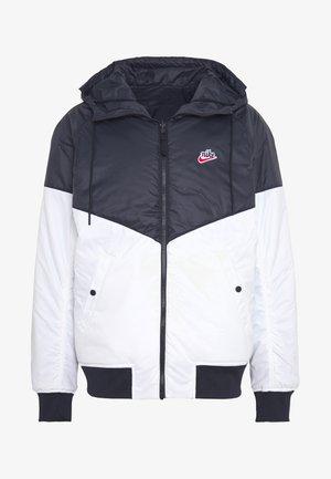 M NSW HE WR JKT HD REV INSLTD - Light jacket - black