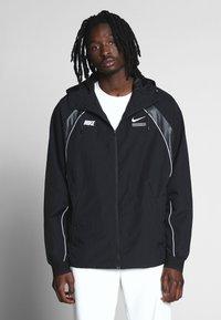 Nike Sportswear - Lehká bunda - black - 0