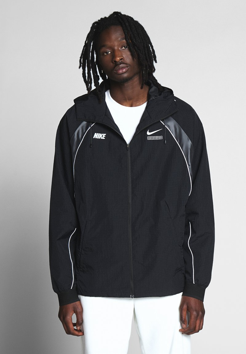 Nike Sportswear - Lehká bunda - black