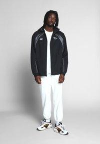 Nike Sportswear - Lehká bunda - black - 1