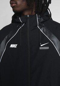 Nike Sportswear - Lehká bunda - black - 4