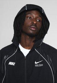 Nike Sportswear - Lehká bunda - black - 3