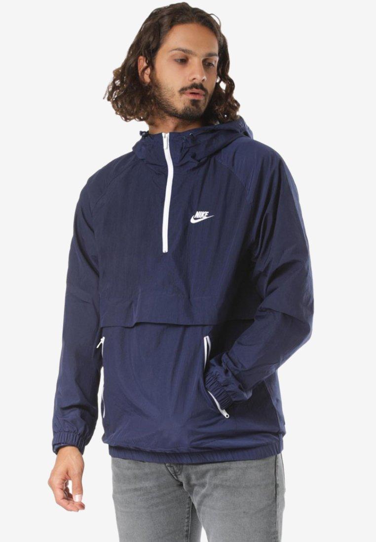 Nike Sportswear - REGULAR FIT - Windbreaker - blue