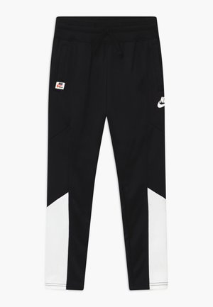 HERITAGE - Tracksuit bottoms - black/white