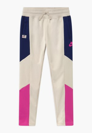 HERITAGE - Tracksuit bottoms - orewood/blue void/fire pink