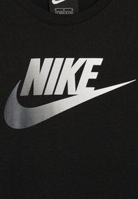 Nike Sportswear - DRESS FUTURA - Robe en jersey - black - 3