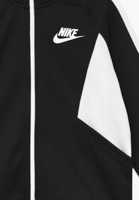 Nike Sportswear - G NSW HERITAGE FZ - Training jacket - black/white - 3