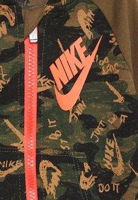 Nike Sportswear - CRAYON CAMO COVERALL - Jumpsuit - cargo khaki - 2