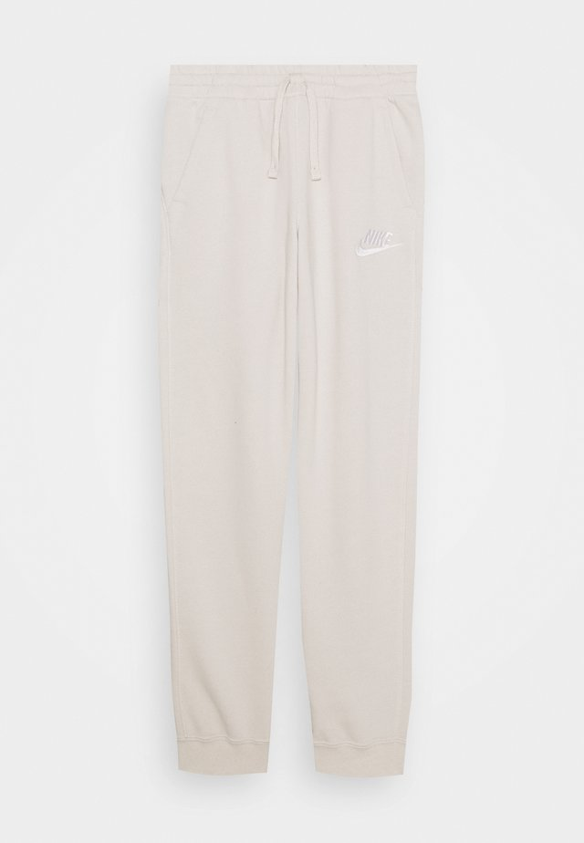 CLUB PANT - Tracksuit bottoms - beige