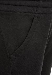 Nike Sportswear - CLUB PANT - Teplákové kalhoty - black - 3
