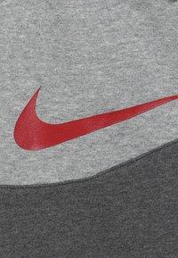 Nike Sportswear - PANT - Trainingsbroek - charcoal heather/dark grey heather/university red - 4