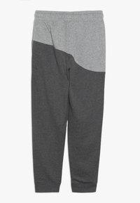 Nike Sportswear - PANT - Trainingsbroek - charcoal heather/dark grey heather/university red - 1
