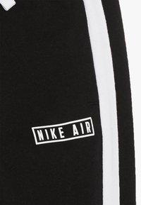 Nike Sportswear - AIR PANT - Træningsbukser - black - 4