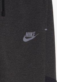 Nike Sportswear - TECH PANT WINTERIZED - Tracksuit bottoms - black/heather - 4