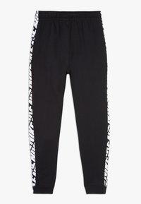 Nike Sportswear - ENERGY PANT - Spodnie treningowe - black/white - 1