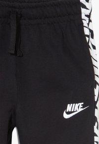 Nike Sportswear - ENERGY PANT - Spodnie treningowe - black/white - 3
