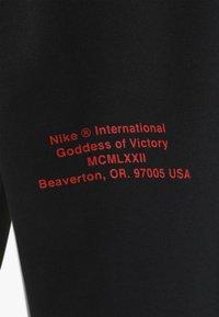 Nike Sportswear - Teplákové kalhoty - black/white - 4