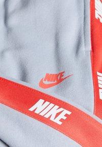 Nike Sportswear - HYBRID PANT - Tracksuit bottoms - charcoal heather/black - 2