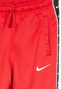 Nike Sportswear - TAPE - Pantalon de survêtement - university red/white - 3