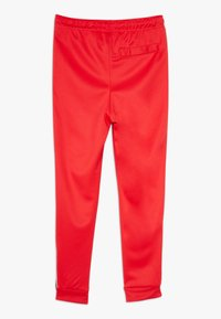 Nike Sportswear - TAPE - Pantalon de survêtement - university red/white - 1