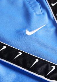 Nike Sportswear - TAPE - Teplákové kalhoty - pacific blue - 2