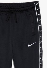 Nike Sportswear - TAPE - Trainingsbroek - black/white - 4