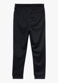 Nike Sportswear - TAPE - Trainingsbroek - black/white - 1