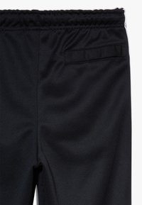 Nike Sportswear - TAPE - Trainingsbroek - black/white - 2