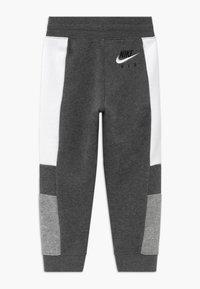 Nike Sportswear - Pantalon de survêtement - charcoal heather - 1