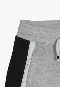 Nike Sportswear - AIR - Pantalon de survêtement - dark grey heather/white/black - 2
