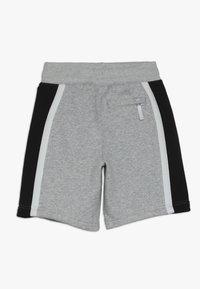 Nike Sportswear - AIR - Pantalon de survêtement - dark grey heather/white/black - 1