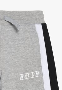 Nike Sportswear - AIR - Tracksuit bottoms - grey heather - 2