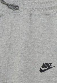 Nike Sportswear - Tracksuit bottoms - dark grey heather/black - 3
