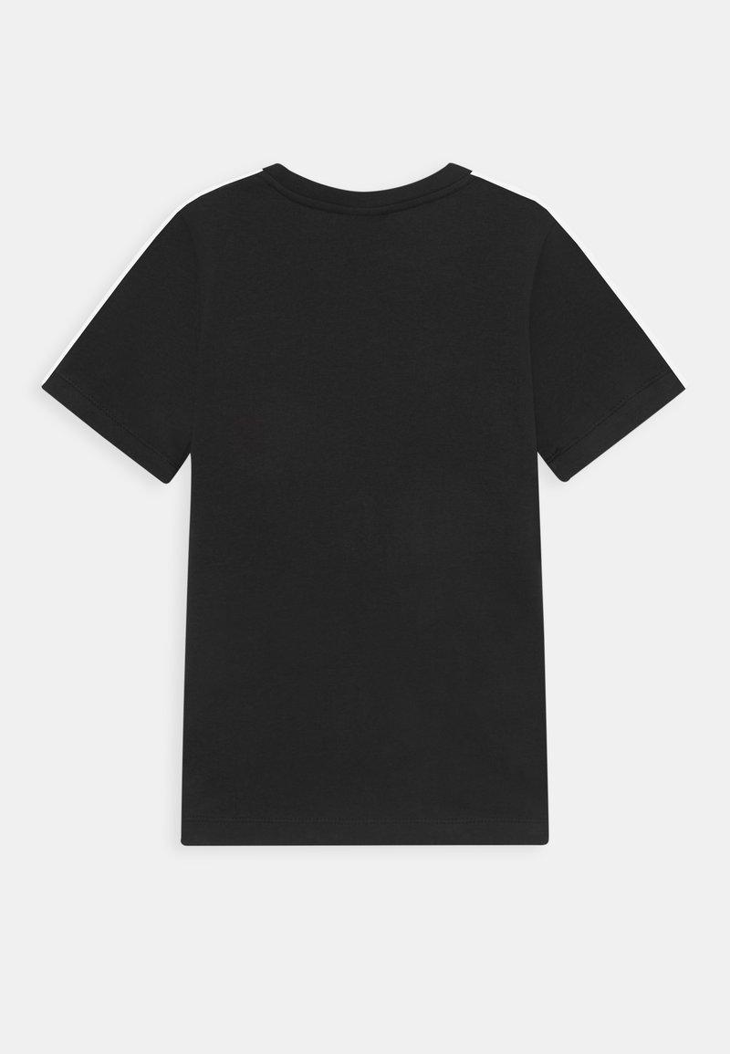 Nike Sportswear - TEE TAPE - T-shirt z nadrukiem - black/white