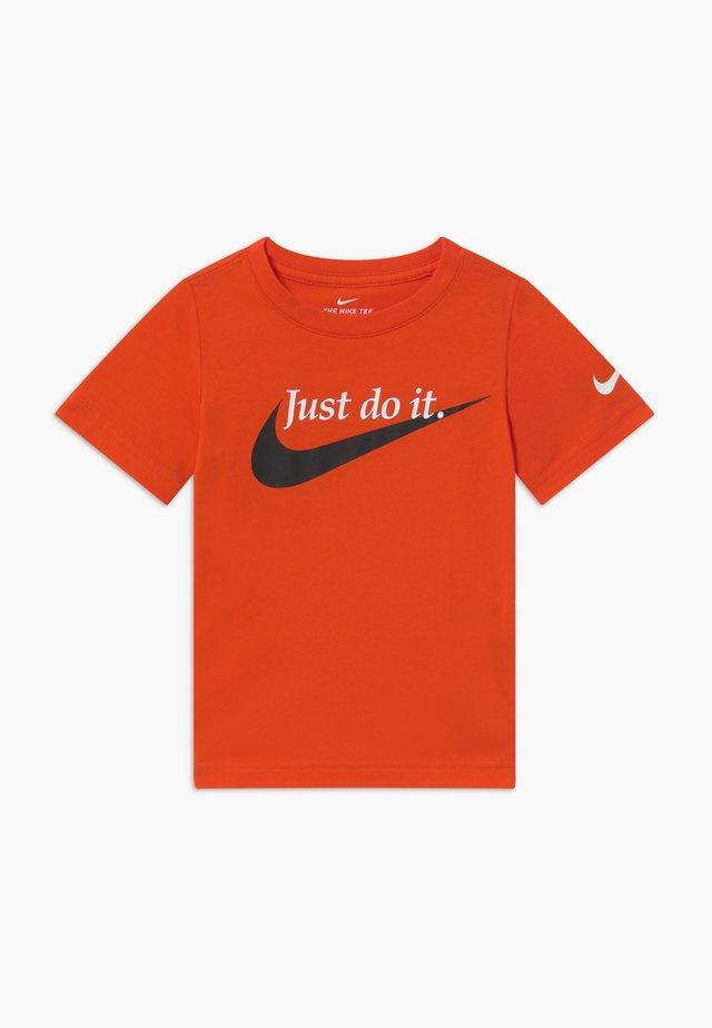 PALATINO - T-shirt med print - orange