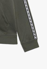 Nike Sportswear - HOODIE TAPED - Training jacket - medium olive/white - 2