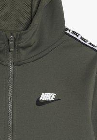 Nike Sportswear - HOODIE TAPED - Training jacket - medium olive/white - 4