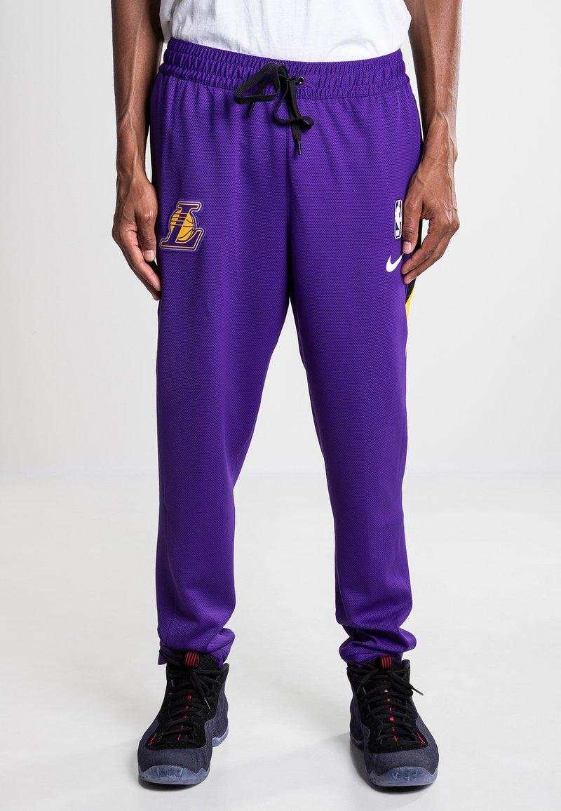 Nike Sportswear - NBA THERMOFLEX SHOWTIME - Tracksuit bottoms - field purple/black
