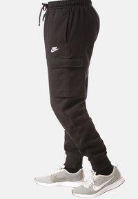 Nike Sportswear - Spodnie treningowe - black - 2