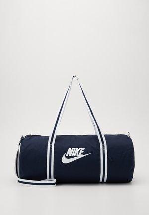 HERITAGE - Sports bag - obsidian/white