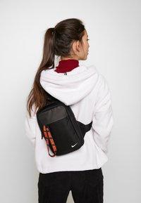 Nike Sportswear - NIKE SPORTSWEAR ESSENTIALS HÜFTTASCHE - Across body bag - black/white - 7