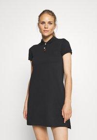 Nike Golf - The Nike Polo Damenkleid - Sportovní šaty - black - 0