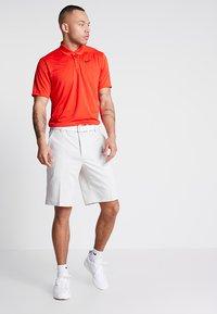 Nike Golf - DRY VICTORY - Piké - habanero red/black - 1