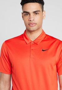 Nike Golf - DRY ESSENTIAL SOLID - Funktionströja - habanero red - 4