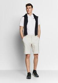 Nike Golf - DRY VICTORY SOLID - Funkční triko - white/black - 1