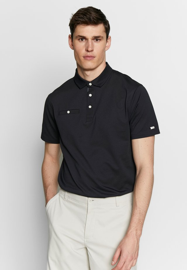 PLAYER SOLID - Polo shirt - black