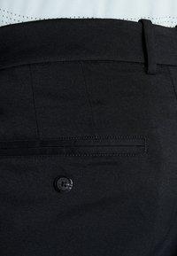 Nike Golf - FLEX PANT CORE - Kangashousut - black - 4