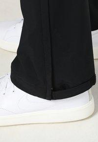 Nike Golf - HYPERSHIELD PANT CORE - Pantalon classique - black - 3